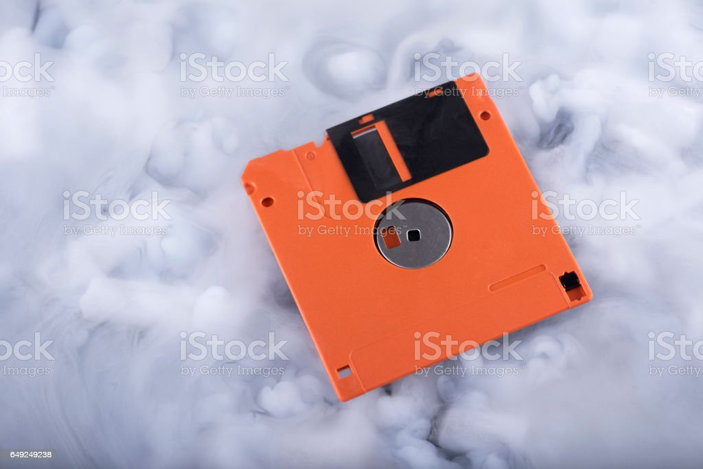 Close-up floppy disk in the clouds stock photo