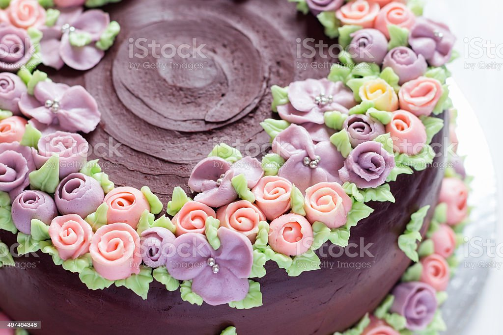 Closeup floral decoration on chocolate cake stock photo