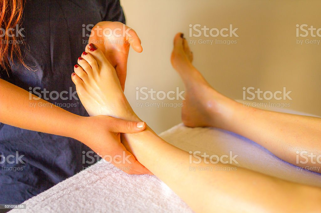 Close-up foot and Leg massage therapy male body spa treatment stock photo