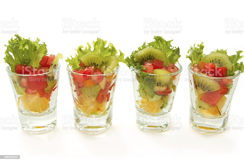 Closeup Fresh fruit salad in glasses royalty-free stock photo