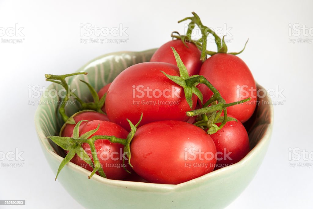 Close-up fresh tomatoes in green bowl royalty-free stock photo