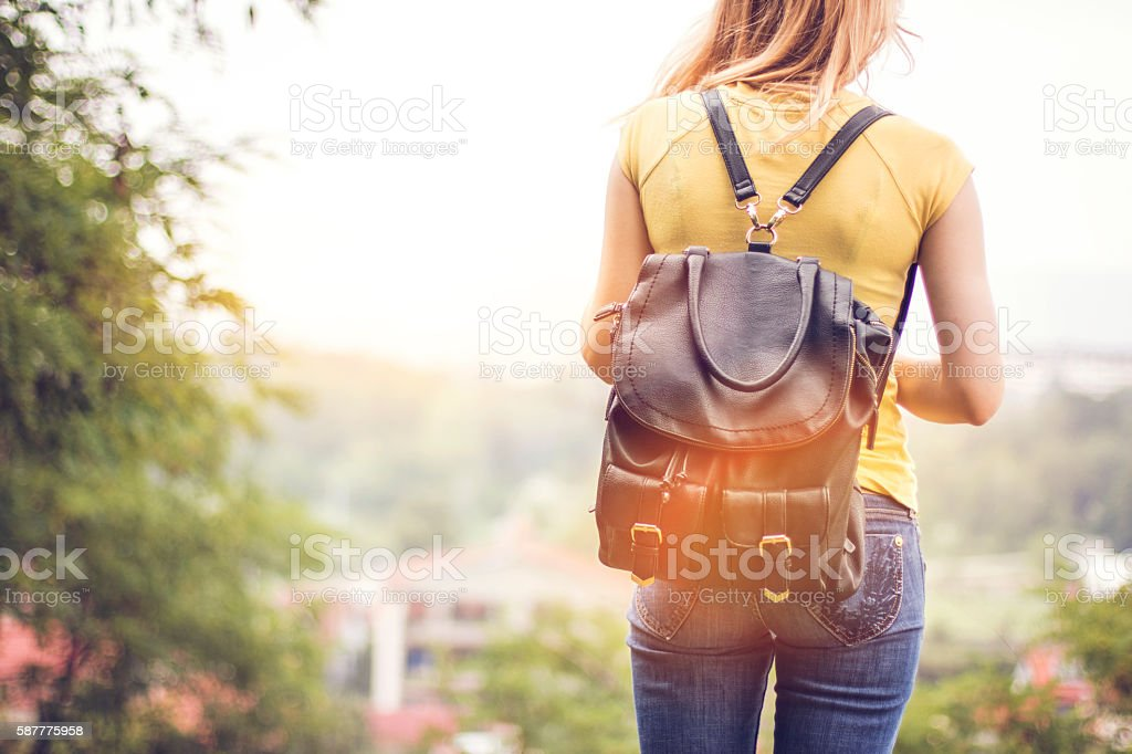 Closeup, Girl looking away and wearing backpack stock photo