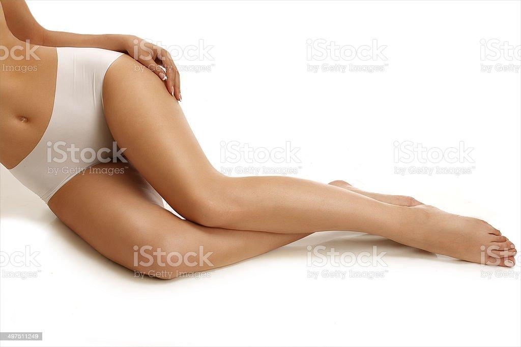 Closeup girl lying on the floor showing beautiful legs stock photo