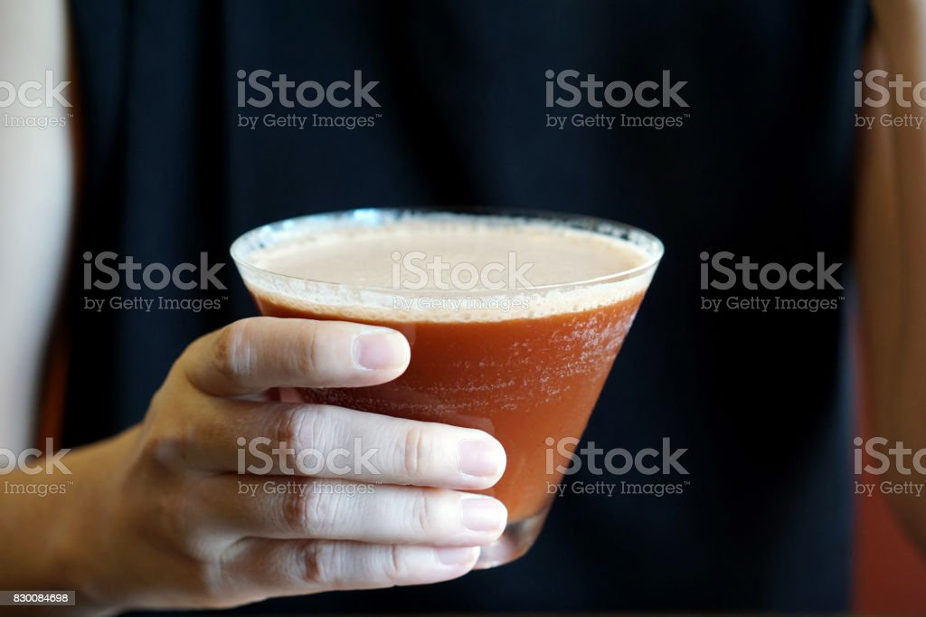 Closeup glass of Iced coffee with strawberry syrup, mango syrup and soda on wooden tray. stock photo