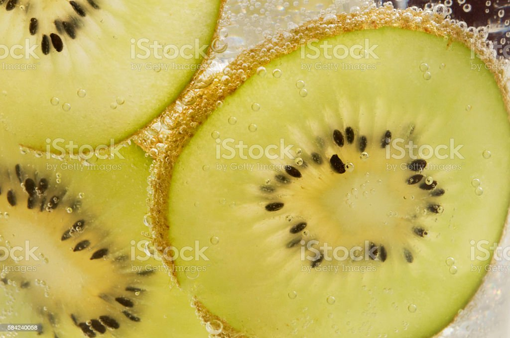Close-up glass of iced kiwi soda drink stock photo