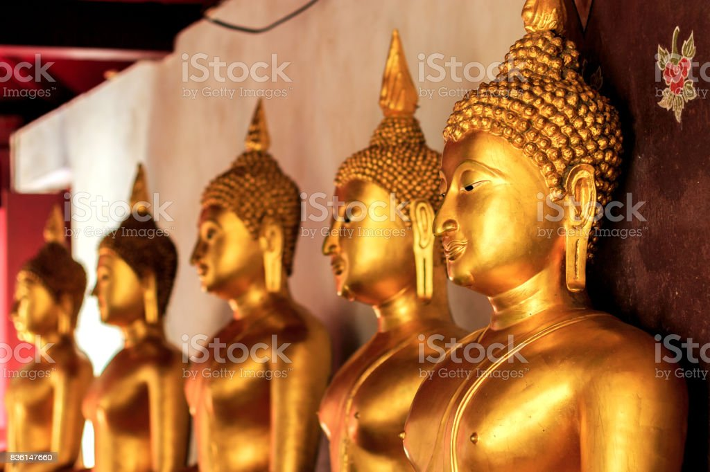 closeup golden buddha with soft-focud and over light in the background stock photo