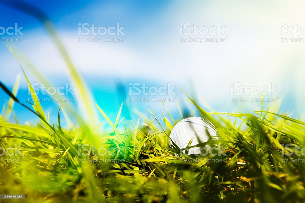 Close-up golf ball in long grass, rough, problem, adversity, frustration stock photo
