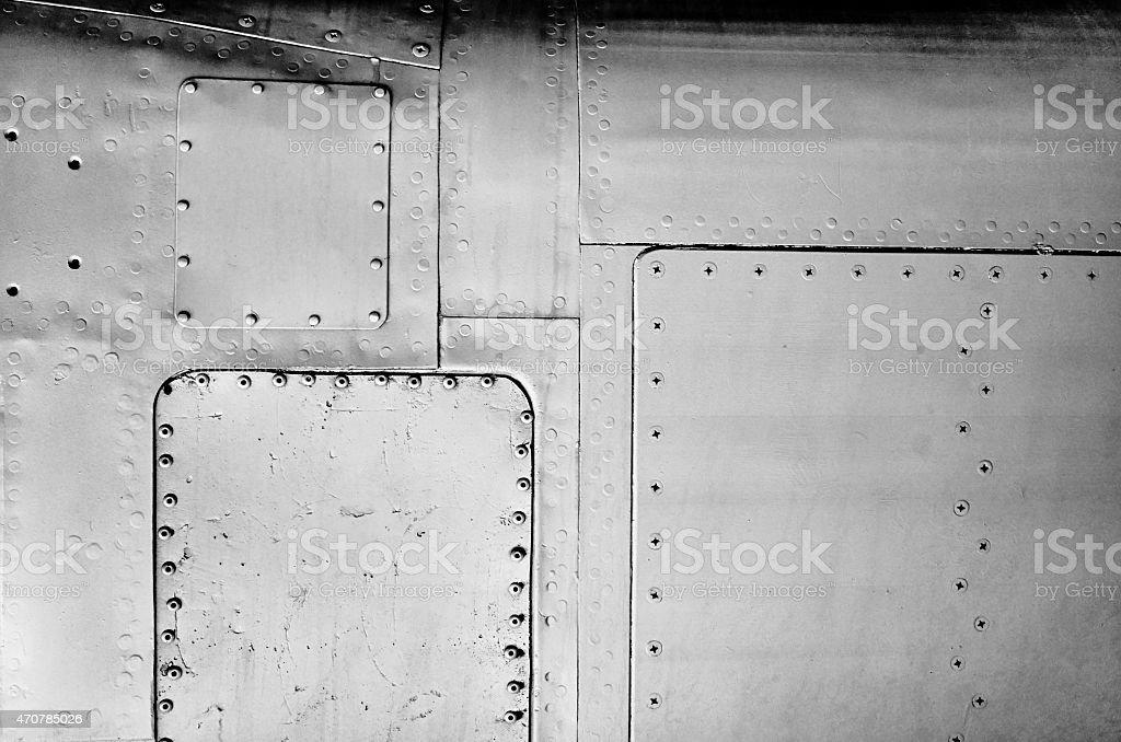 Close-up gray painted aluminum aircraft sheet metal background texture stock photo