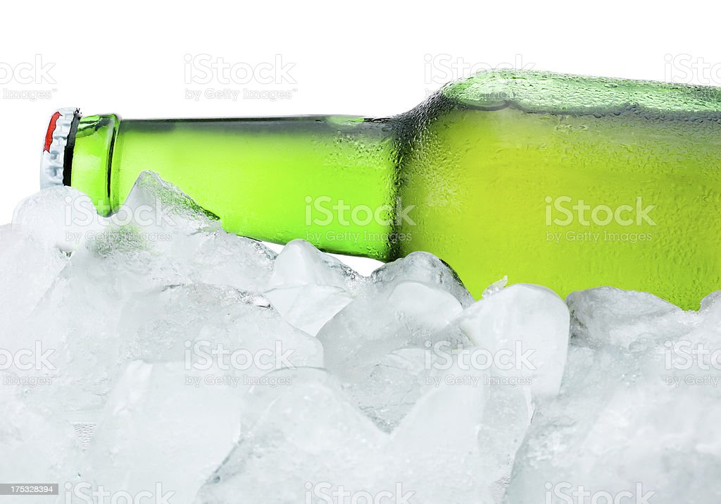 Close-up Green Bottle with Condensation cool in ice isolated royalty-free stock photo