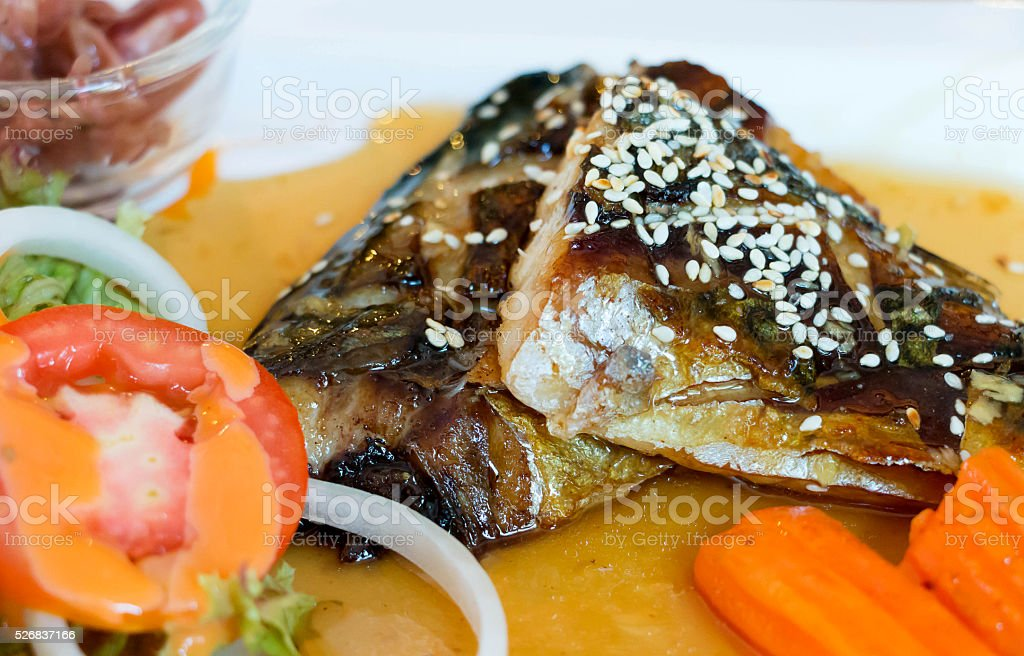 closeup grilled fish fillets on white plate stock photo