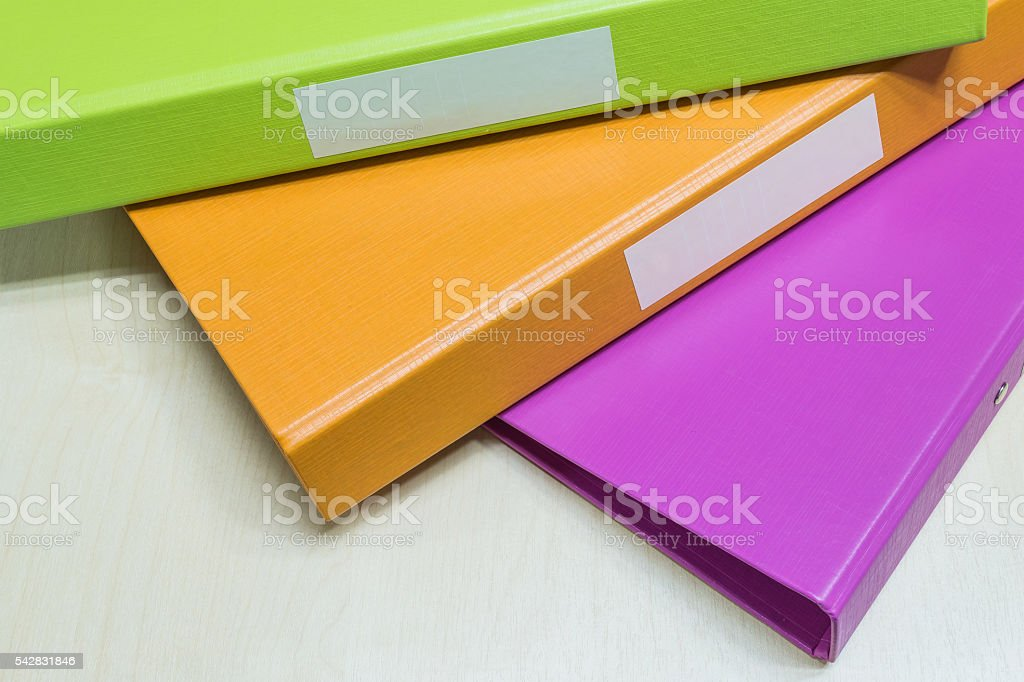 Closeup group of colorful document file on wood desk background stock photo