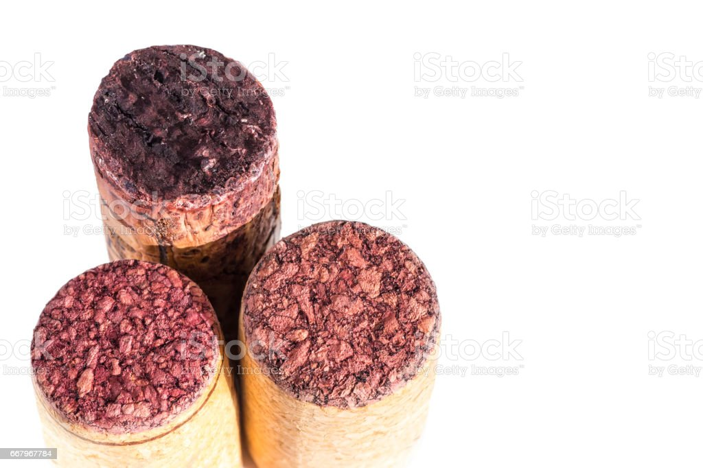 Close-up group of three different wine corks already used bottle stopper in studio isolated on white background stock photo