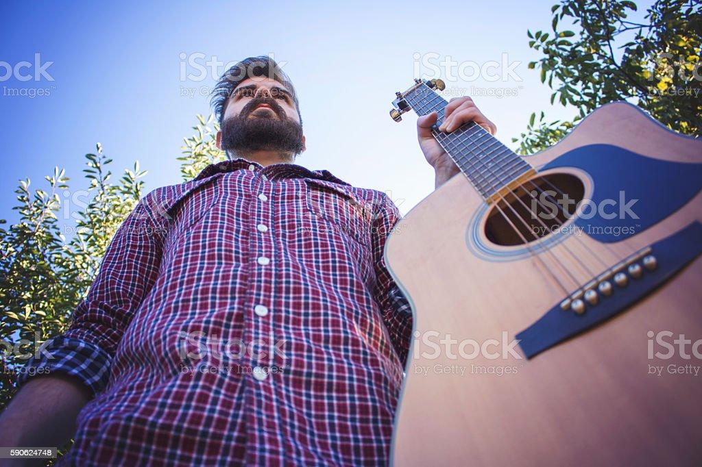 Closeup, guy holding the guitar stock photo