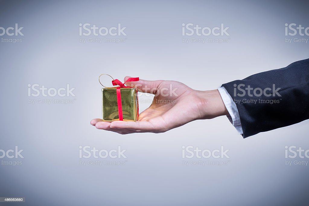 Close-up hand businessman give the small gift box stock photo