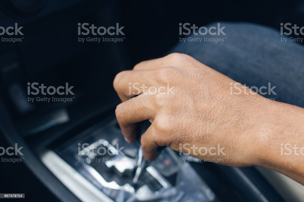 Closeup hand change gear while driving car stock photo