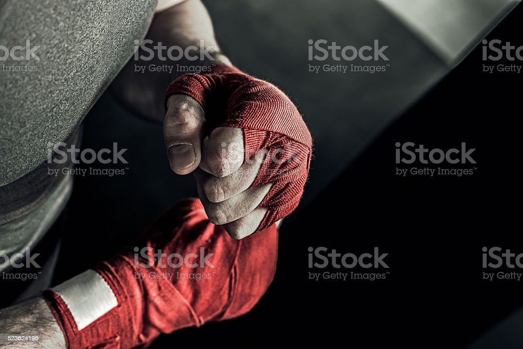 Closeup hand of boxer with red bandages stock photo