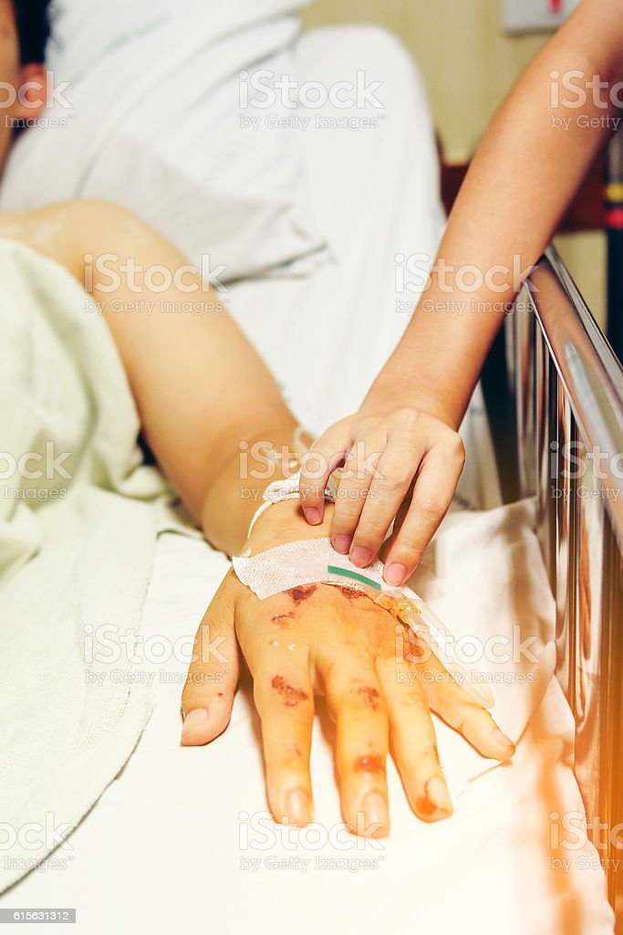 Close-up hand of nurse and patient the hospital with stock photo
