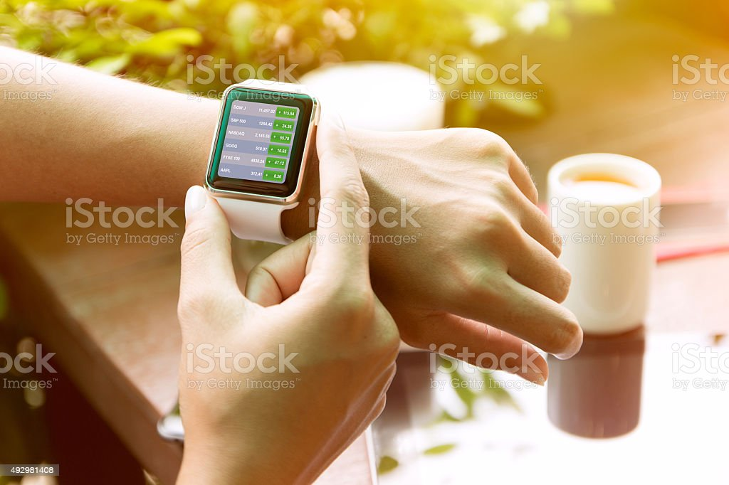 closeup hand using watch check stock finance stock photo