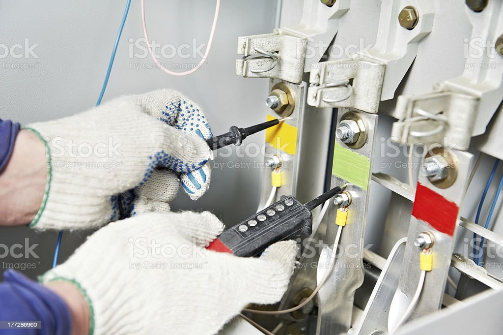 Close-up Hands of Electrician measure voltage stock photo