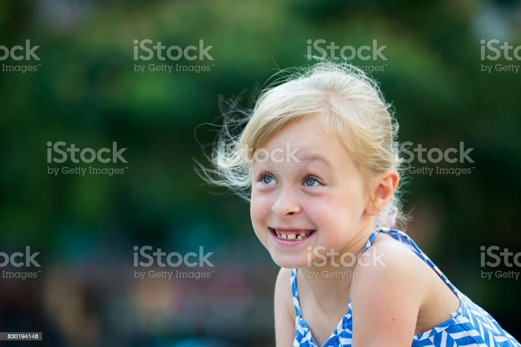 Closeup happy little girl stock photo
