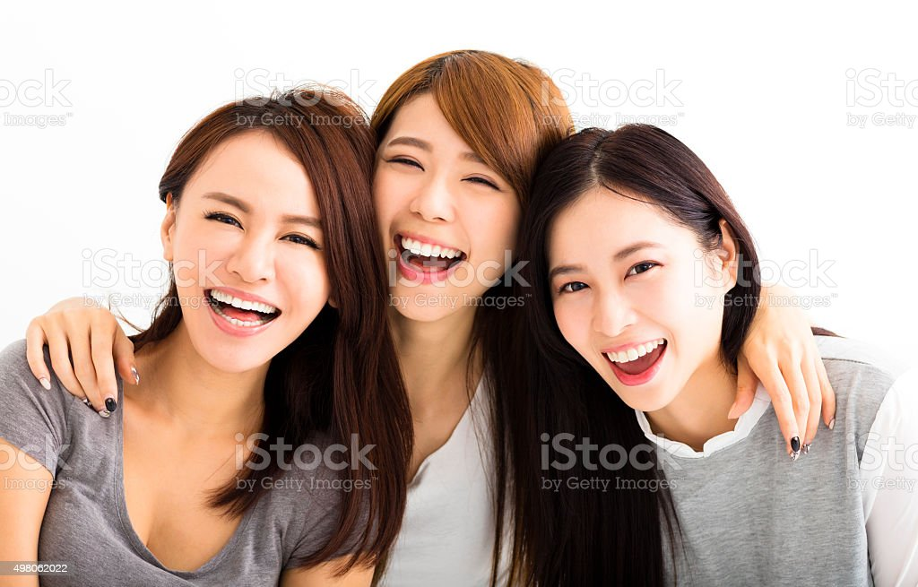 Closeup happy Young Women Faces Looking at Camera stock photo