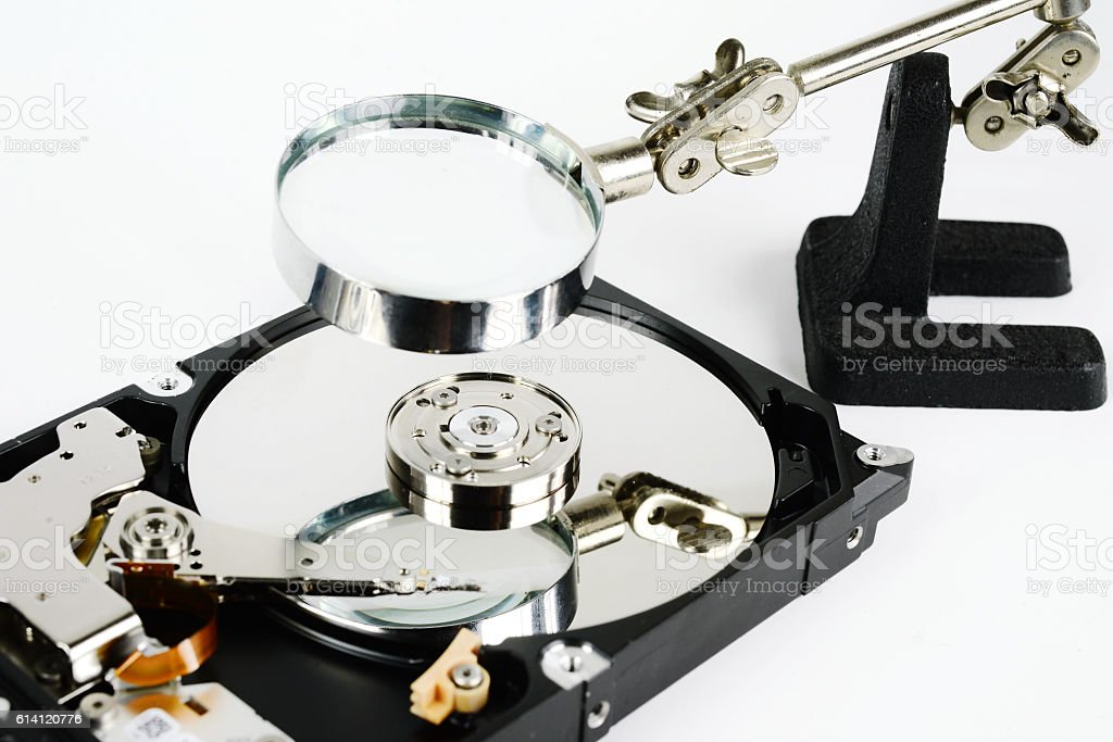 closeup - hard disk repair  and magnifying glass stock photo