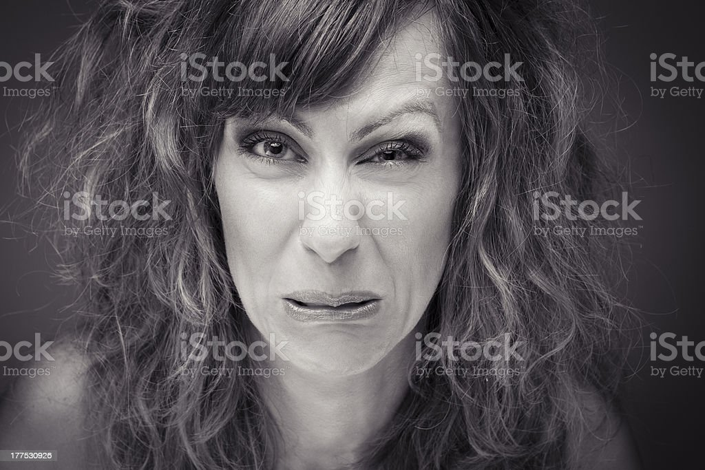 Close-up head shot of woman pulling funny face stock photo