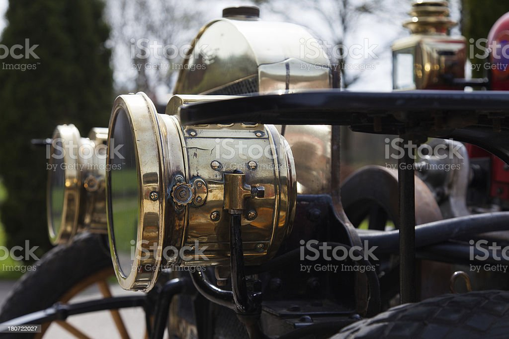 Close-up: headlights of an antique 1908 car royalty-free stock photo