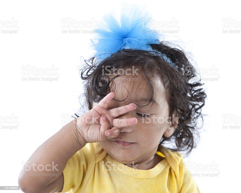 Closeup Headshot of Mixed Race Sleepy Toddler Girl Rubbing Eyes stock photo