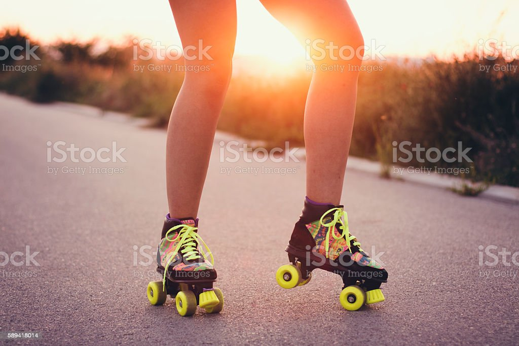 Closeup, human legs driving roller skates stock photo