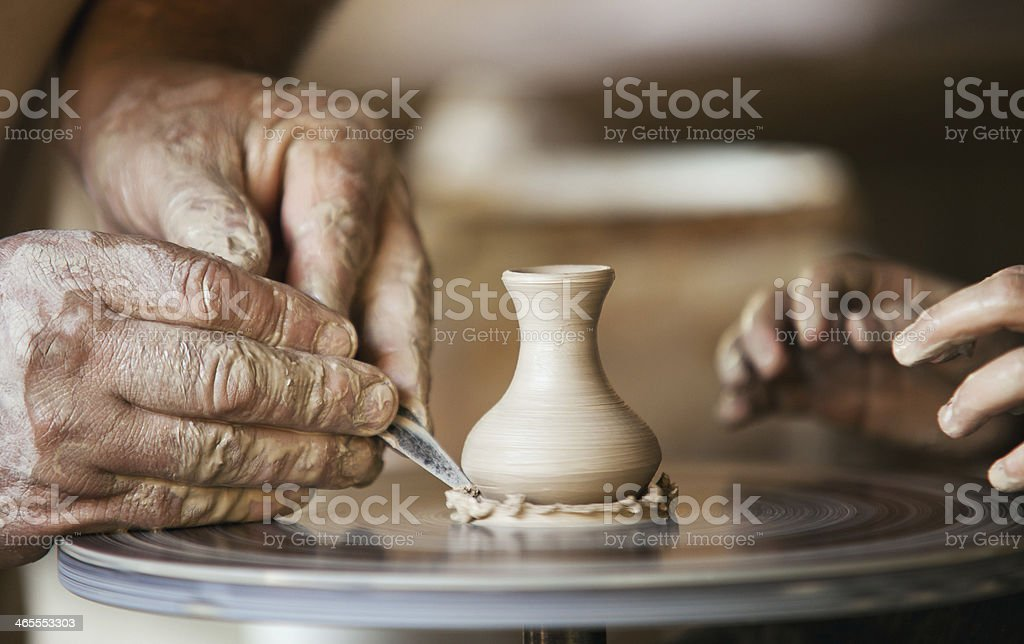 Closeup image ceramist man hands royalty-free stock photo
