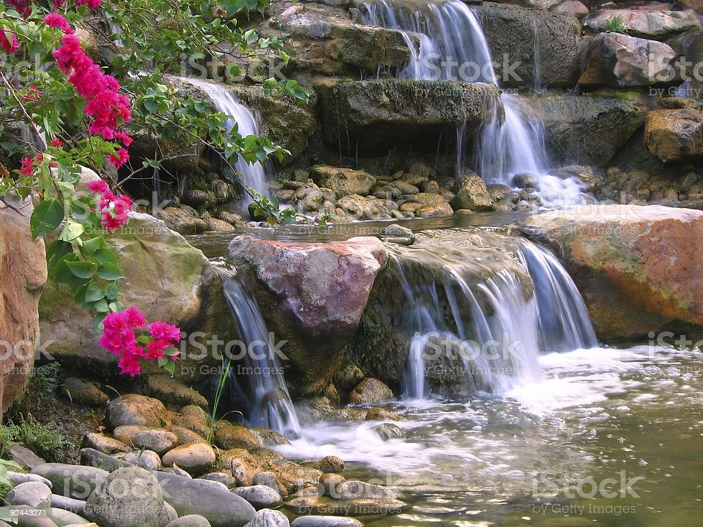 A close-up image of a garden waterfall royalty-free stock photo