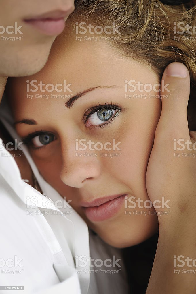 Closeup image of a girl and boy holding her head stock photo