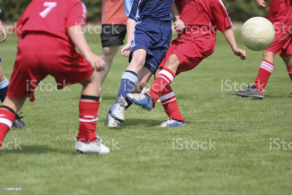 A close-up image of a soccer game in motion stock photo