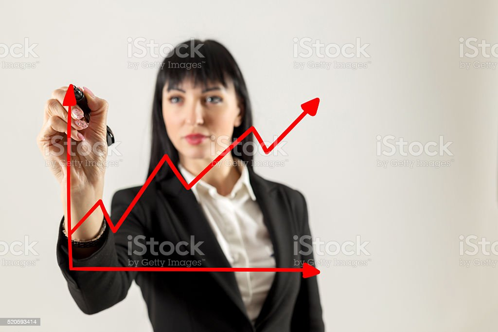 Closeup image of businesswoman drawing graph stock photo