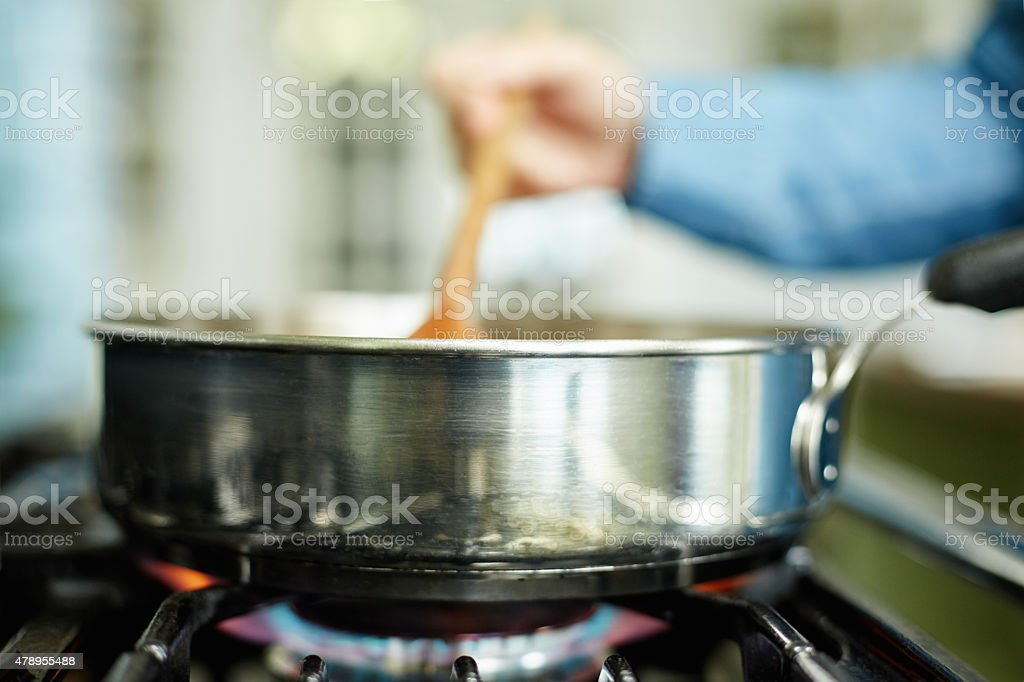Close-up image of food being cooked in pan on stove stock photo