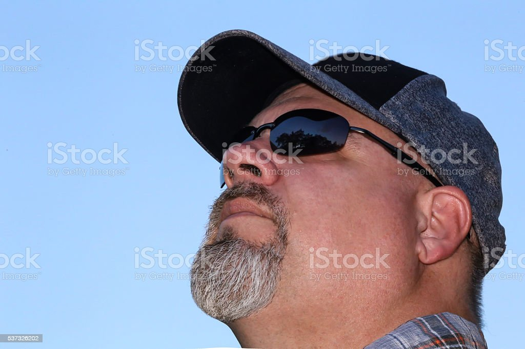 Close-up Image of Man With Goatee and Sunglasses stock photo