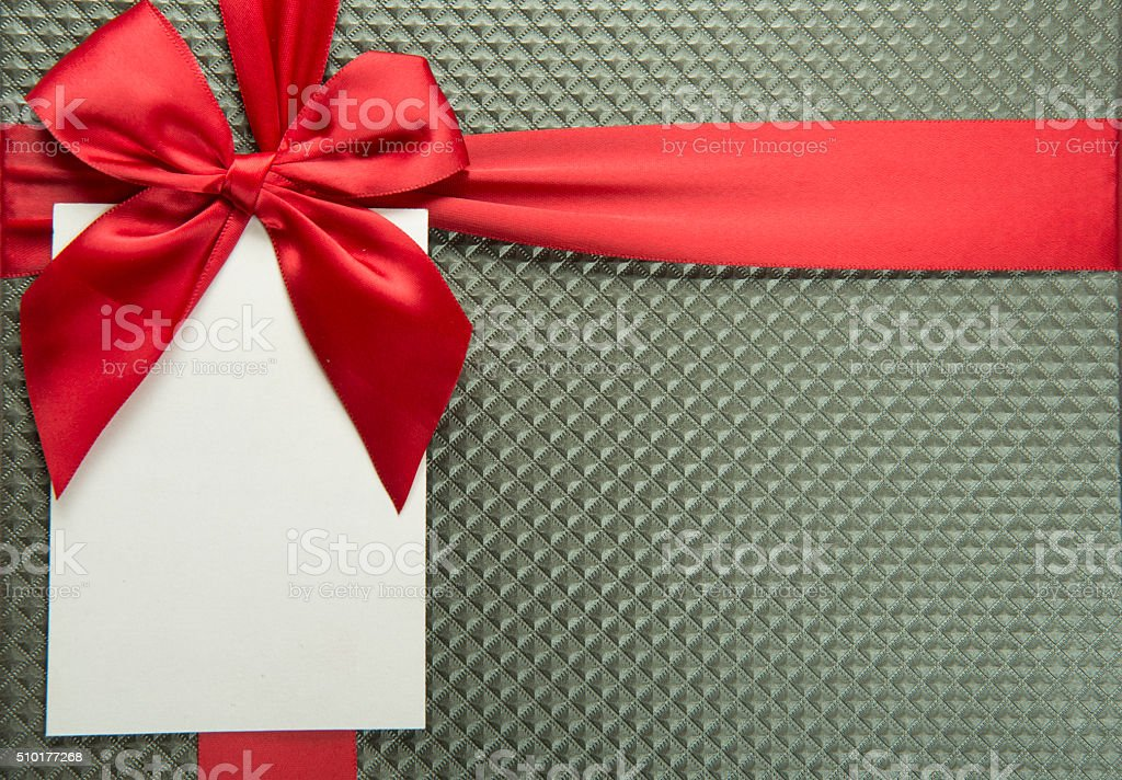 Close-Up Image Of Red Ribbon And Gift Tag stock photo