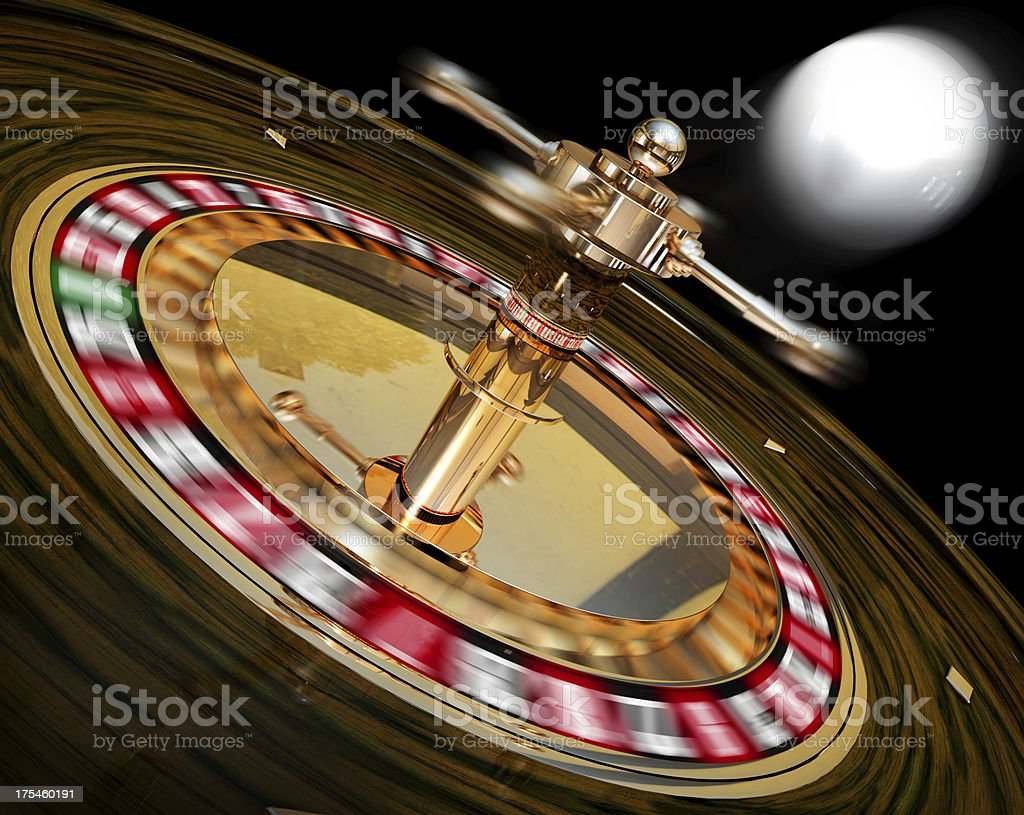 Close-up image of spinning roulette on black background stock photo