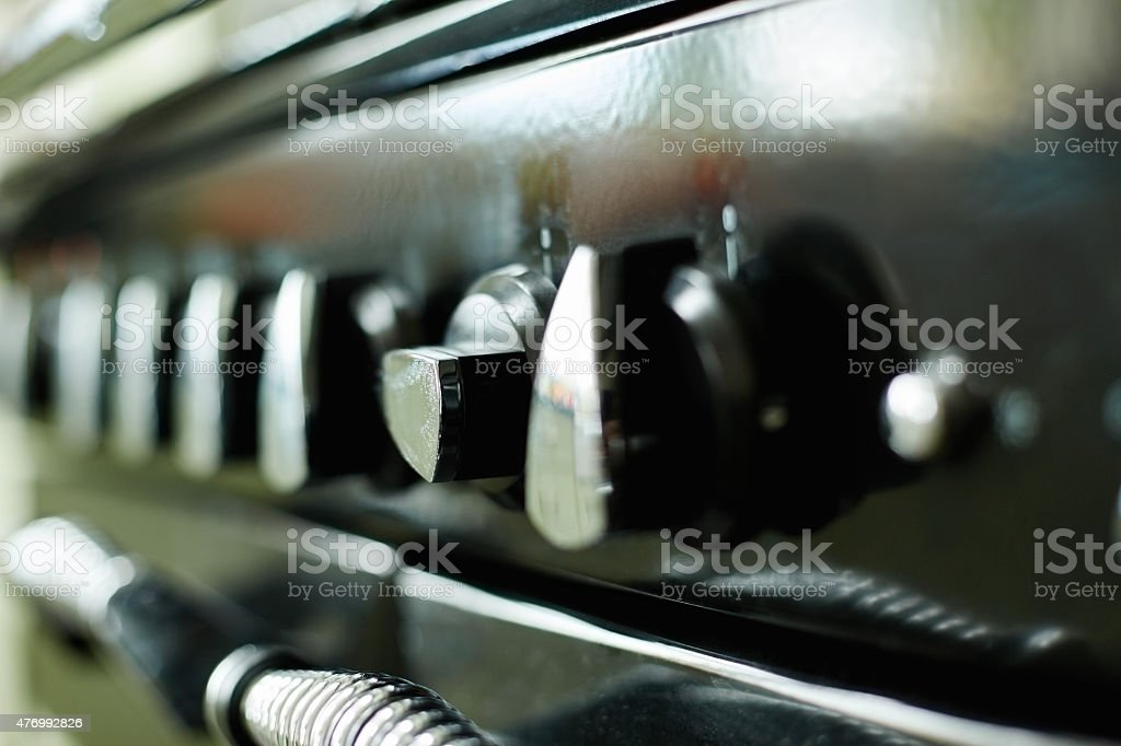 Close-up image of stove controllers stock photo