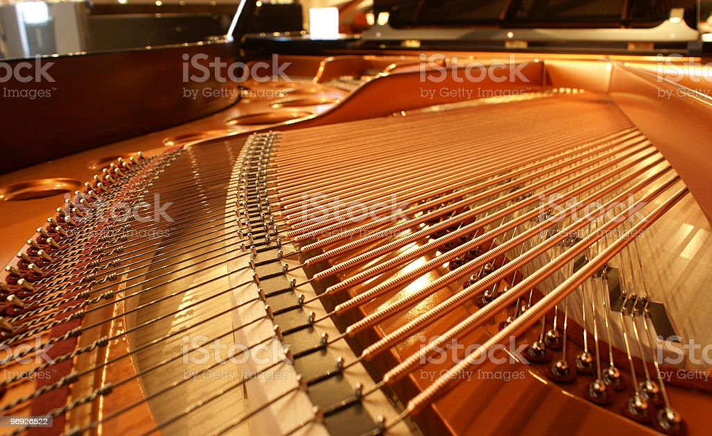 A close-up image of the inside of a piano stock photo