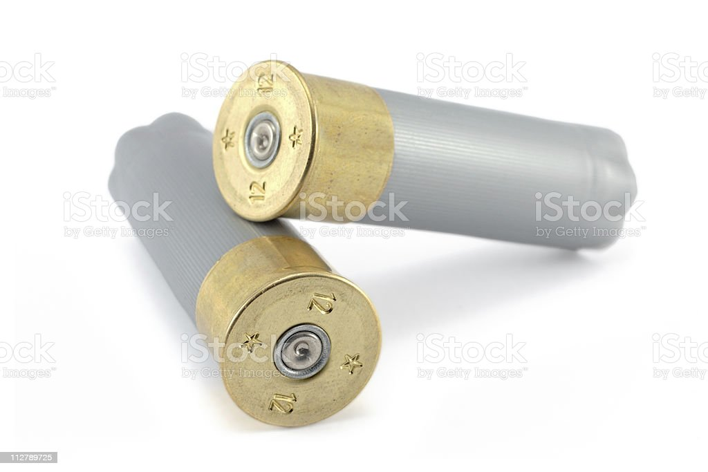 Close-up image of two shell casings on white background stock photo