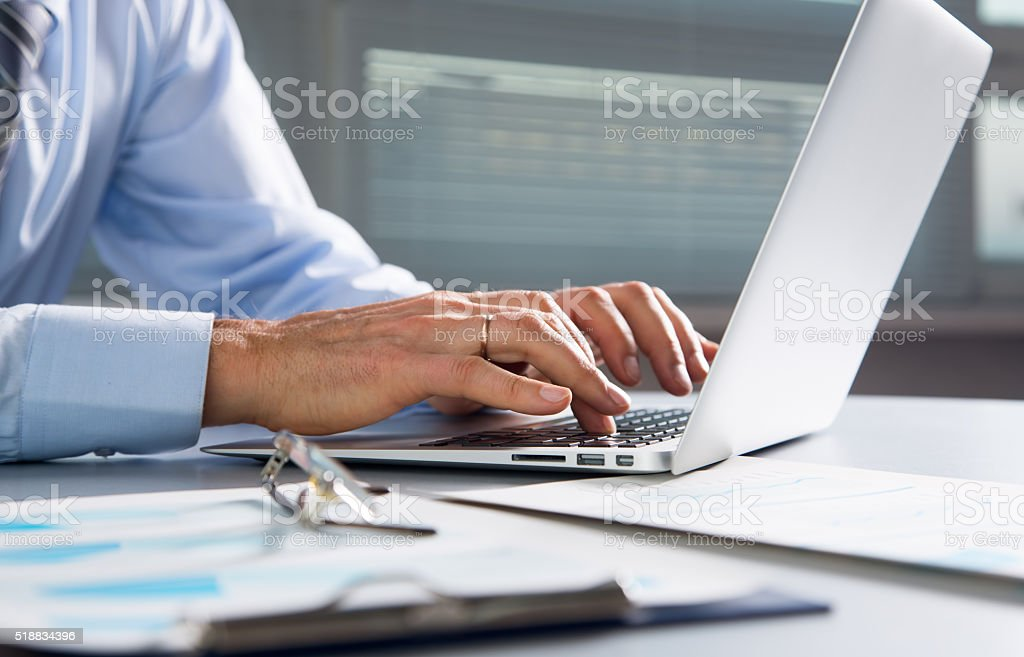 Close-up image of typing male hands stock photo