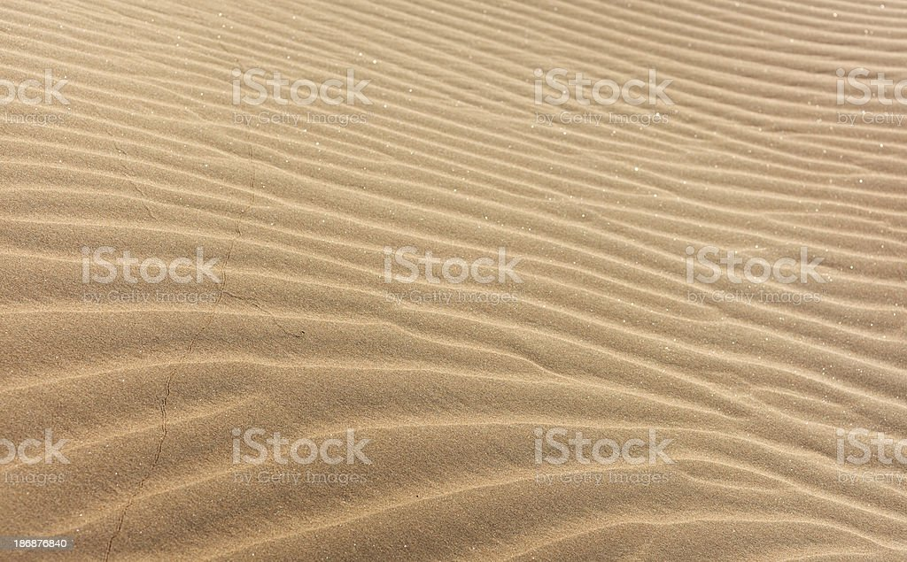 Close-up image of waves of light brown sand royalty-free stock photo