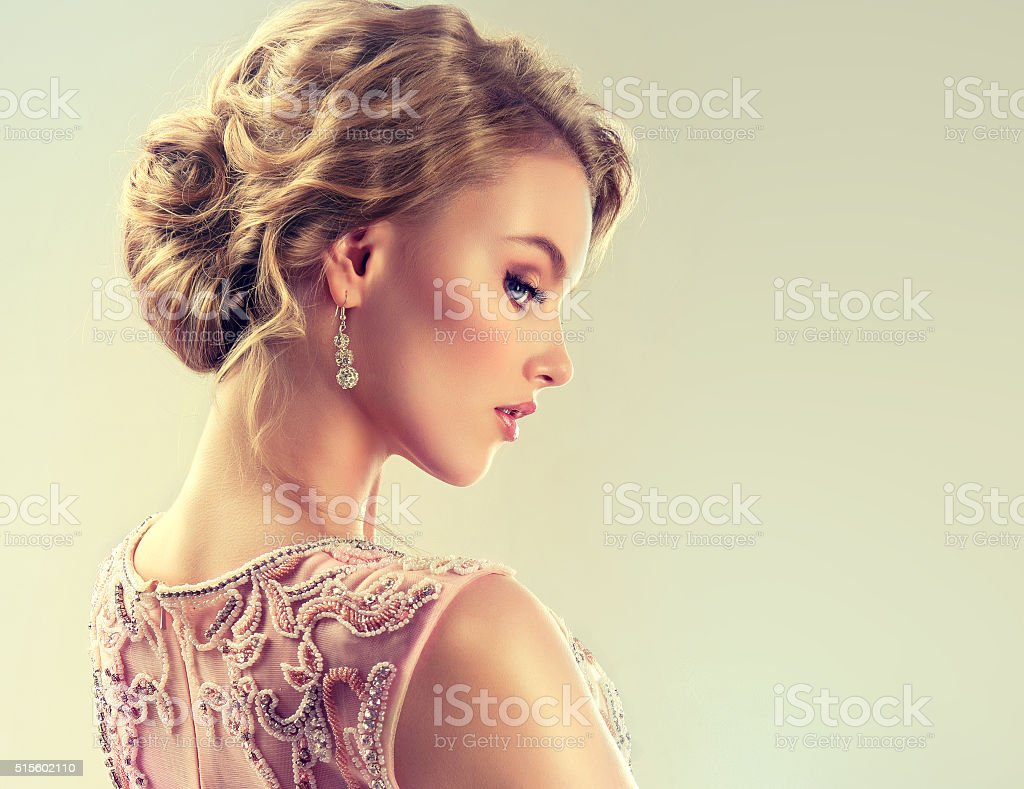 Close-up image of wedding and evening hairstyle. stock photo