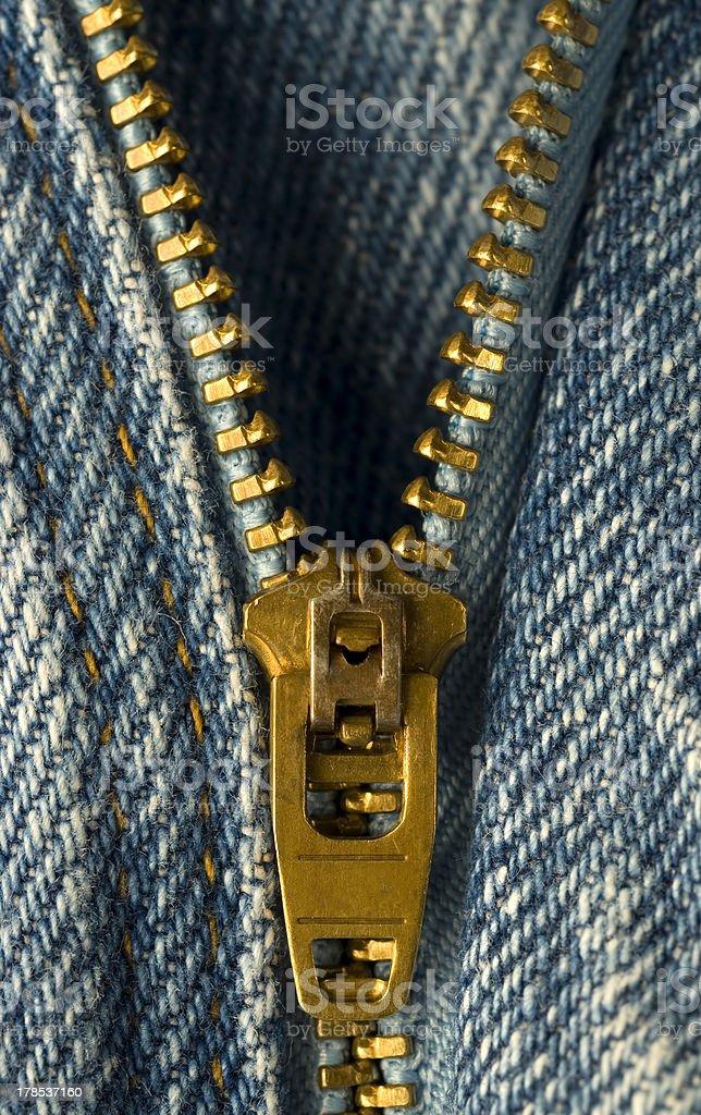 Closeup image of zipper on denim jeans royalty-free stock photo