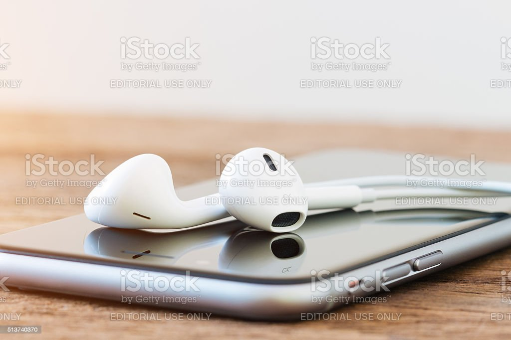 closeup iphone and earpods device on table stock photo