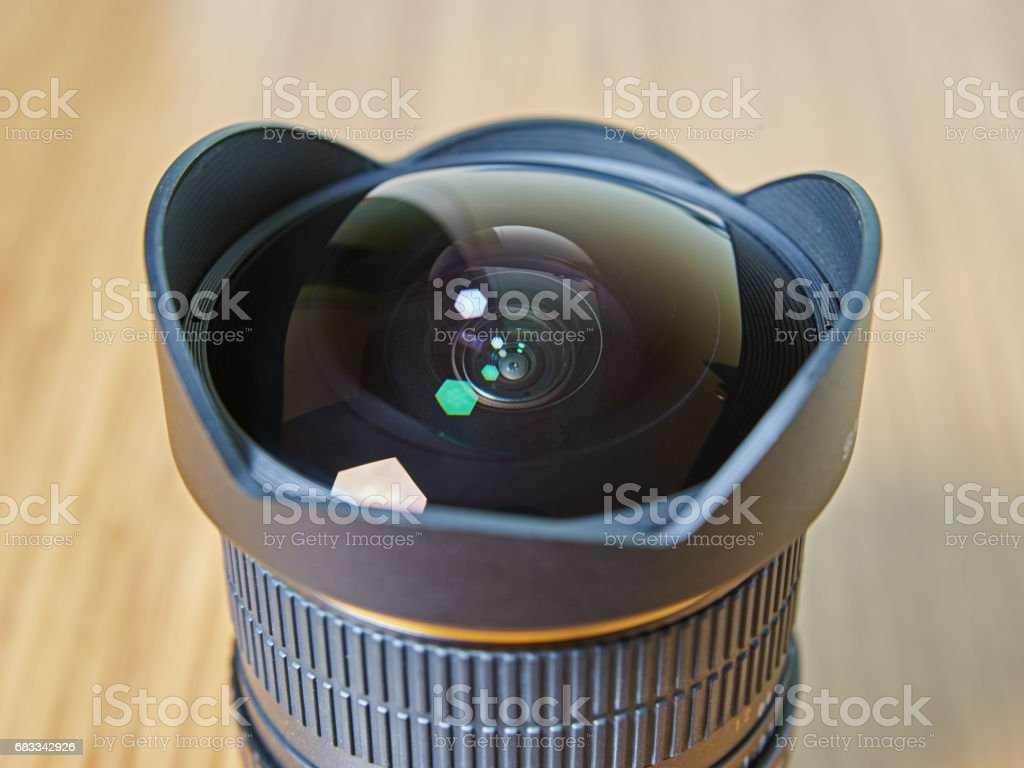 Closeup isolated view of the fisheye lens for the single lens reflex camera stock photo