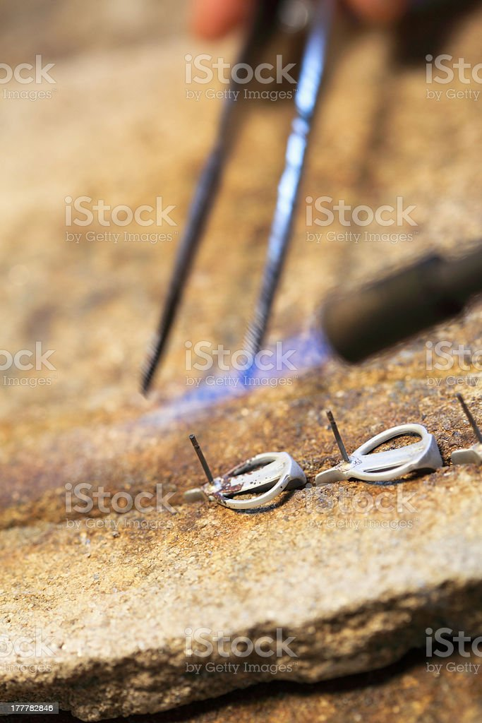 Closeup jeweller at work silver soldering royalty-free stock photo