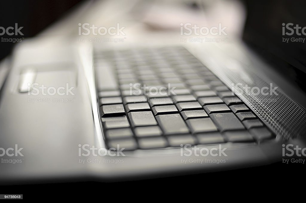 close-up laptop with shallow DOF stock photo